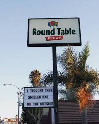 round table pizza sign i thought they smelled bad on the outside e