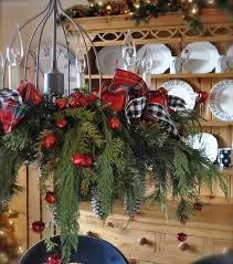 cute chandelier with plaid ribbon bows fir branches and red jungle bells