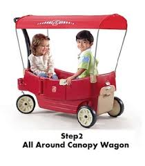 Compare Kids Pull Along Canopy Wagons Radio Flyer Or Step2