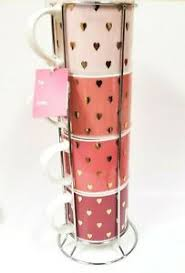 This stacking mugs with rack has a smooth edging. New 4 Grace Porcelain Stack Able Pink Gold Hearts Tea Cup Coffee Mug Silver Rack Ebay