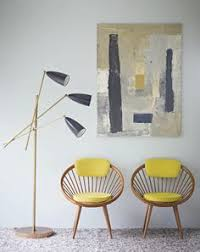 retro contemporary furniture. modern retro chairs with banded seats and yellow cushions art painting on wall contemporary furniture