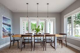 interior designer noelle miceck says the bottom of a chandelier should be 66 inches from the floor in a dining room and when you re sitting next to a
