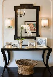 mirrored entryway furniture. chic foyer with black mirroredtop console table wicker basket paired fretwork mirrored entryway furniture f