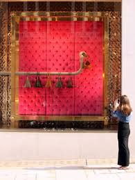 louis vuitton window display. a woman takes photograph of faye\u0027s window display in the louis vuitton shop on new bond street mayfair. n