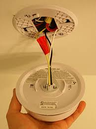 replace an ac powered smoke detector that is hard wired to the smoke detector removed from base showing 3 wire pigtail supplying power to detector