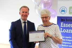 Jill Finch with Premier and award - Anglicare