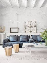 instead rooms are brighter the brick painted a crisp white furnishings have a lighter footprint with spindled legs and a bit of a rustic feel