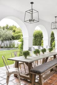high end outdoor dining furniture. spanish colonial neutral patio with dining table high end outdoor furniture