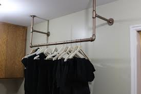 hanging clothes rod from ceiling