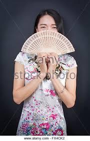 holding hand fan. beautiful asian woman holding a hand fan - stock image