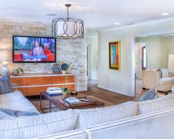 transitional living room features stone