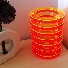 yellow and orange circular layered table lamp