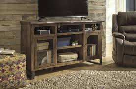 signature design esmarina large tv stand with fireplace audio option walnut brown w815