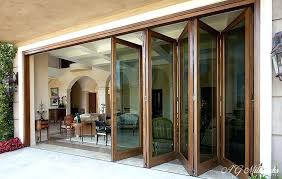 sliding accordion door wooden folding door bi fold add a practical and attractive feature to any home with wooden patio doors that bring the garden and the