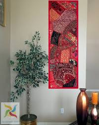 red rajasthan wall hanging with decorative pins