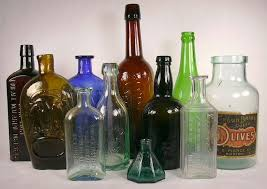 grouping of historic bottles dating between 1840 and 1940
