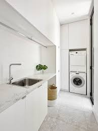 laundry room furniture. inspiration for a modern lshaped gray floor laundry room remodel in melbourne with furniture t
