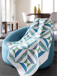 This calming quilt features strip-pieced triangle units in springy ... & This calming quilt features strip-pieced triangle units in springy blue,  green and white Adamdwight.com