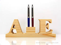 Wooden pen holders (2)