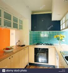 modern kitchen tiles. Turquoise Wall Tiles In Modern Kitchen With Pale Wood Units And Fitted Wall-cupboards Opaque Glazed Doors I