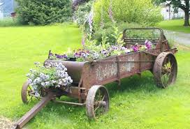 flower garden wagon this one utilizes old farming equipment for a country chic look for a flower garden wagon