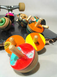 tiny wooden spinning tops by board on