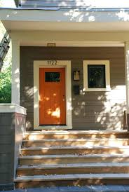 Orange front door Paint White House With Grey Trim Orange Wooden Front Door Design Ideas And Brown Siding Plus Black Workfuly White House With Grey Trim Orange Wooden Front Door Design Ideas And