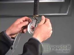 installing safety cables for an extension spring garage door