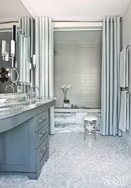 gray bathroom with tall double shower curtain