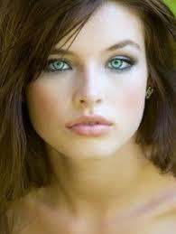 pale skin light green eyes and um brown hair