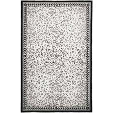 white animal print area rugs