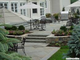 raised concrete patio design ideas patio with outdoor kitchen and fireplace in new jersey raised landscaping e85 patio