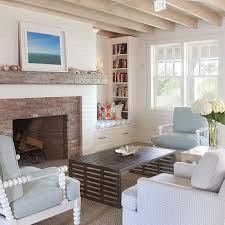 fireplace with brick surround and chunky mantle