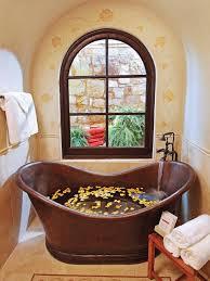 mediterranean style bathroom with copper soaking tub