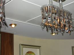 the light fixtures were made from forks spoons and knives