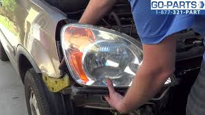 replace honda cr v headlight bulb how to change replace 2002 2006 honda cr v headlight bulb how to change install 2003 2004 2005 ho2519104