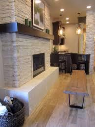 white stone goldern floor dark mantle and dark furniture a rustic but modern fireplace