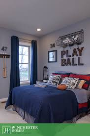 Model Bedroom Interior Design With Floor Length Blue Curtains And Red And Navy Bedding This