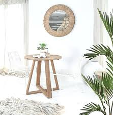 rattan dining chairs white chair styled two are at a brown wooden table in an and rattan dining chairs