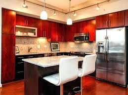 cherry cabinets with black quartz countertops wood floors kitchens cabinet dark wo