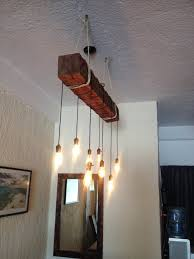 absolutely wood beam chandelier reclaimed with rope unique iron diy canada uk australium light