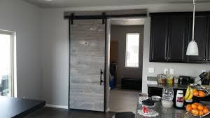 building a barn door using reclaimed barn wood in a steel frame woodworking metal working you