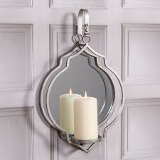 large mirrored silver candle holder