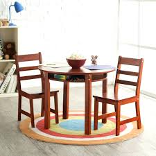 appealing round cherry wood toddler kitchen table with storage and 2 piece ladder back chair design