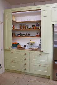 Bifold Kitchen Cabinet Doors Grey Bi Fold Kitchen Cupboard Doors Reveal Wooden Shelving Inside