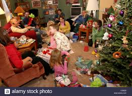 Photo Of Happy Father Giving Christmas Gifts To Surprised Sons Giving Gifts On Christmas