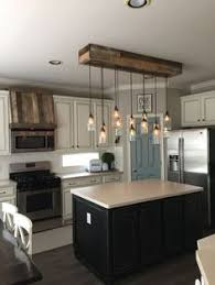 lighting a kitchen. mason jar light and faux oven hood pallet wood lighting a kitchen