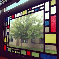 stain glass effect go simple with large colorful squares or get artsy with a mondrian inspired design even better the tissue paper blocks outside
