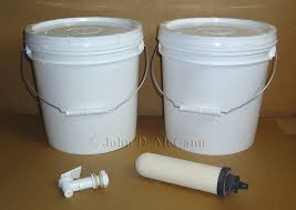 Diy berkey water filter Gravity Feed This Photo Shows The Parts Needed For The Project Two Food Grade Two Gallon Buckets One Spigot And One Ceramic Water Filter i Used Berkey Candle Pinterest Survival Resources u003e Diy Countertop Water Filter