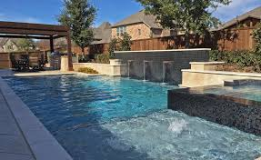 geometric pool copper water bowls iridescent glass tile and travertine walls and spa in